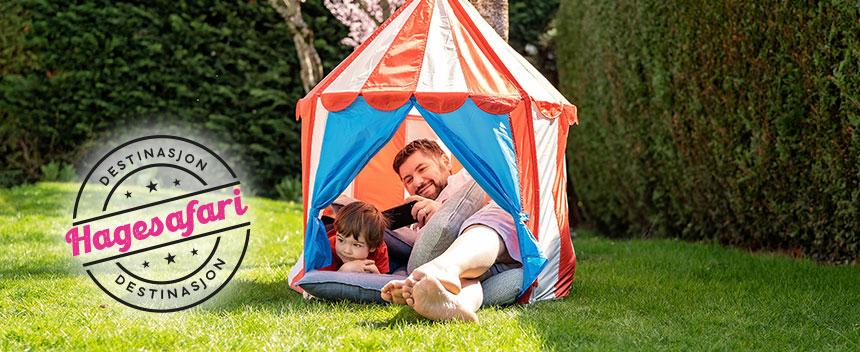 Far og sønn har telttur i hagen